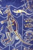 Aboriginal design, Australia. Detail of T-shirt with Aboriginal design of many typical Australian animals royalty free stock photos
