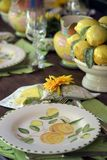 Detail of table decorated for special event. With colored crockery pieces Royalty Free Stock Photography