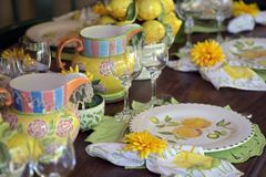 Detail of table decorated for special event. With colored crockery pieces Royalty Free Stock Image