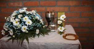 Detail of the table of the offerings on the day of the first communion of a group of boys and girls stock photos