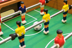 Detail of a table soccer game. Closeup Royalty Free Stock Photo