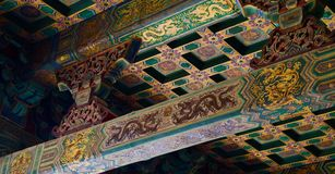 Detail of taditional painted Chinese roof gold and green royalty free stock images
