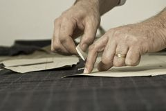Detail of tailor's hand with chalk Royalty Free Stock Photo