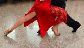 Detail of tango shoes. Detail of tango dancers in milonga ballroom Stock Image