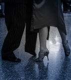 Detail of tango shoes. Detail of tango dancers in milonga ballroom Stock Images