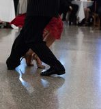 Detail of tango shoes. Detail of tango dancers in milonga ballroom Royalty Free Stock Images