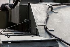 Detail of the tank front view. close-up. Close-up of armor protection of a tank tracked howitzer with a transport cable at the front. dark army background royalty free stock photo