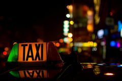 Detail of taxi sign at night Royalty Free Stock Photos