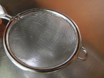 Detail of a tea sifter net. A detail of a tea sifter net Royalty Free Stock Photography