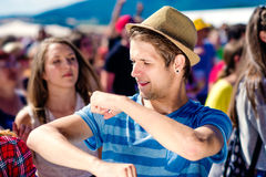 Detail of teenage boy at summer music festival dancing Stock Image