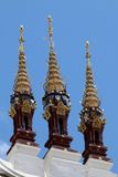 Detail of a Temple Roof. This image shows the decorations on the roof of a temple in Northern Thailand. The decorations are in the form of stylised parasols Royalty Free Stock Photography