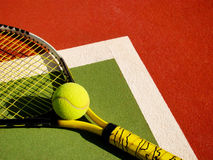 Detail of a tennis court. With ball and racket royalty free stock photography