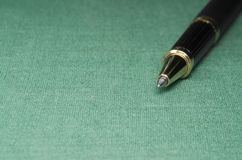 Detail in of textile backgroud with a pen and selective focus Royalty Free Stock Image