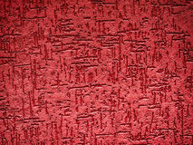 Detail of a textured, red exterior wall Stock Images