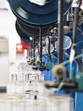 Detail of thread factory production line Stock Photography