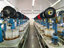 Detail of thread factory production line Royalty Free Stock Image