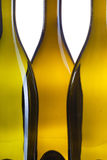 Detail of three empty wine bottles Stock Image