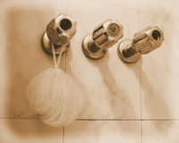 Detail of three faucets in bath Royalty Free Stock Photos