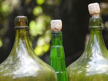 Detail of three glass bottles, with cork stoppers stock photos