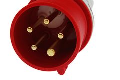 Detail of three phase electric plug connector, red plastic shell, white background stock photo