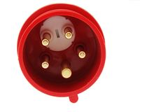 Detail of three phase electric plug connector, red plastic shell, white background royalty free stock photography