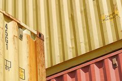 Detail of three steel shipping containers. Weathered steel surfaces of shipping containers stacked in a yard somewhere in Wilmington, California and the Port of Stock Images