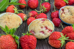 Detail on a Three Strawberry and Mint Muffins on a Old Wooden Bo Royalty Free Stock Image