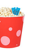 Detail of tickets and popcorn. Detail of popcorn in a bucket and two tickets over a white background. Tickets on focus and shallow depth of field Stock Photography