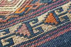 Detail, tightly woven knots. Of vintage Turkish kilim royalty free stock images