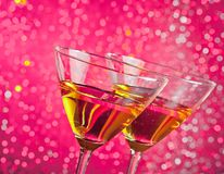 Detail of tilted glasses of cocktail Royalty Free Stock Photo