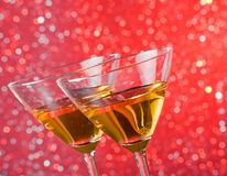 Detail of tilted glasses of cocktail on bar table Royalty Free Stock Photo
