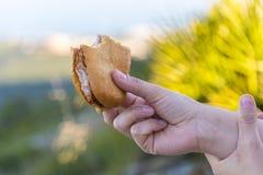 Detail to a steak sandwich. Someone eating a steak sandwich Stock Image