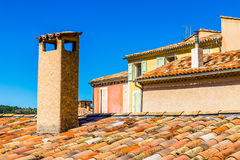 Detail Of The Top Of The Roofs Made Of Red Tiles With Chimneys Stock Images