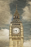 Vintage Big Ben. A detail of the tower of Big Ben, Westminster, London. Vintage faded crumpled paper effect Royalty Free Stock Photo