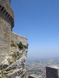 Detail of tower of castle in San-Marino. Detail of tower of castle on top of the rock in San-Marino Stock Photography
