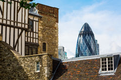 Detail of the Tower of London with the Gherkin in the back in London, UK Stock Images