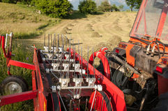 Detail of a tractor in front of hay bales Royalty Free Stock Photography