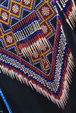 Detail of traditional clothing of tribes of south China. Detail of traditional handmade clothing of tribes of south China Stock Photos