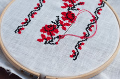 Detail of traditional folk cross stitch floral pattern Royalty Free Stock Image