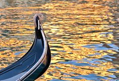 A detail of a traditional gondola floating on water canal in Venice in Italy stock photos