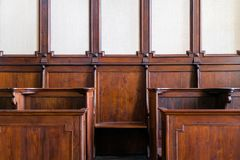 Detail of traditional hard wood courthouse, church choir sitting stock image