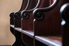 Detail of traditional hard wood courthouse jury, church choir si. Tting area. Interior with empty wooden seats royalty free stock photos