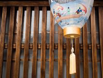 Japanese paper lantern in front of traditional house Royalty Free Stock Photo