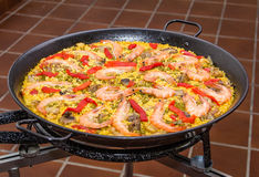Detail of traditional spanish paella cooked in a pan royalty free stock image