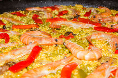 Detail of traditional spanish paella cooked in a pan stock photography