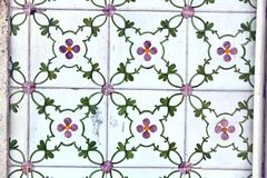 Detail of traditional  tiles on facade of old house Royalty Free Stock Photo