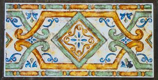 Detail of the traditional tiles from facade of old house. Decorative tiles.Valencian traditional tiles. stock photography