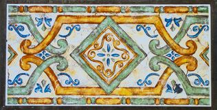 Detail of the traditional tiles from facade of old house. Decorative tiles. Stock Photos