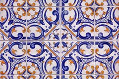 Detail of traditional tiles on facade of old house stock images