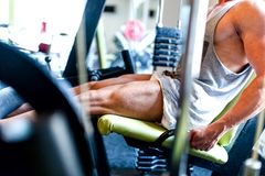 Detail of training, close-up of muscular bodybuilder working out Stock Photography